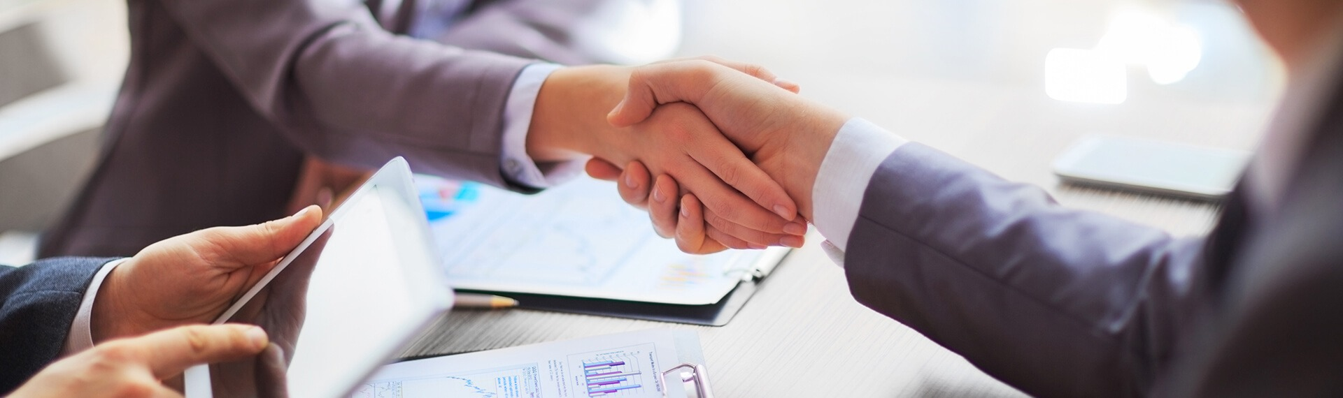 Businessman shaking hands with a business solicitor