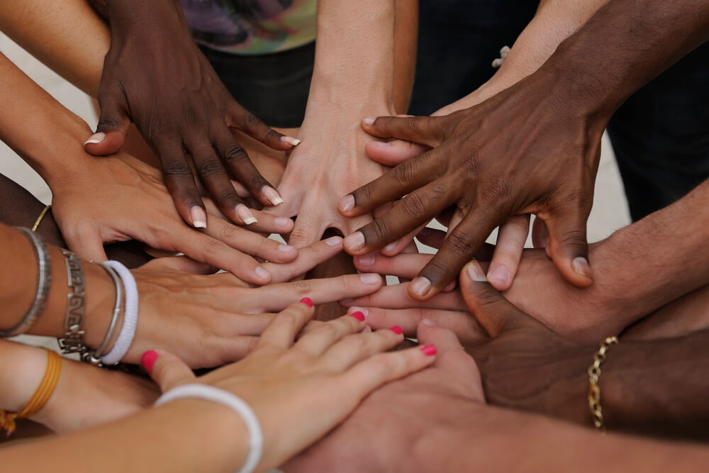 Family Law Solicitors shown by many hands together in our personal legal services dept